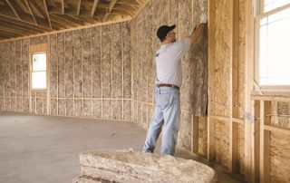 Bulk insulation installed in timber walls.