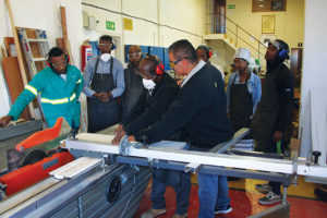 Students are exposed to various machinery during the woodworking course.