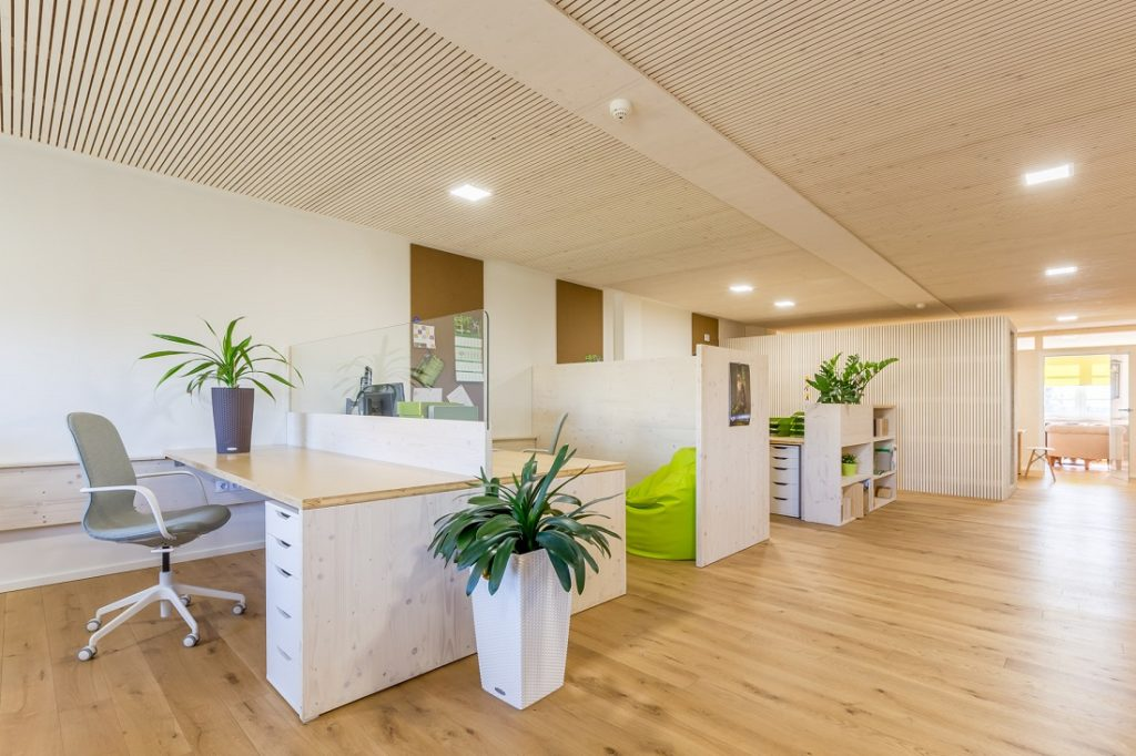 Research conducted shows that office with wood elements encourage productivity among employees. Image credit: HWZ International