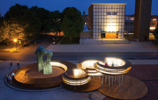 The Conversation Plinth lights up the evening. Image credit: Hadley Fruits/IKD