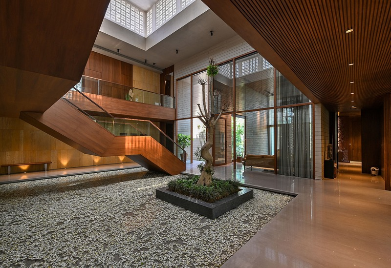 Wood with muted colours was among the materials used for the house. Image credit: Dinesh Mehta