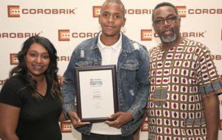 Senzo Mamba (middle) with his award, with Shauneez Naidoo (left) and Dr Finzi Saidi (right). Iamge credit: Corobrik