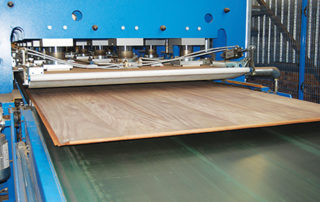 Veneered boards are used to produce flat panels such as doors, tops and panels for cabinets, shopfitting and furniture. Credit: Pearlman veneers