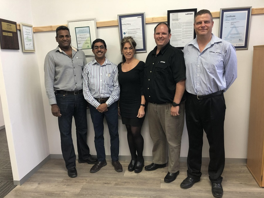 Denise Conradie (centre) with the Lonza management team (from left): Martin Reddy (Environmental Health & Safety Manager); Kesun Govender (Operations Manager); JJ du Plessis (Senior Business Manager) and Ross Skorpen (Financial Manager). Image credit: Lonza