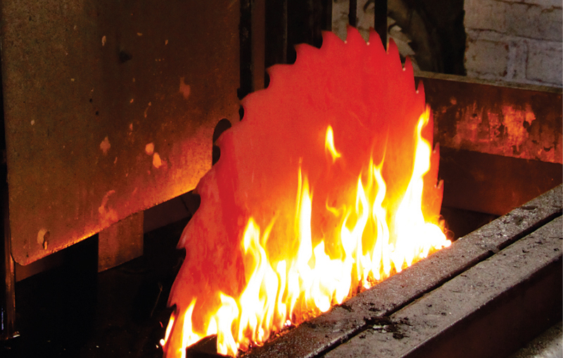 Each blade is heated and quenched in oil as part of the hardening process.