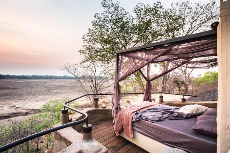 Each accommodation unit features a viewing tower and a mosquito net-enclosed bed that can slide out from its canvas-clad canopy into the open air, allowing guests to sleep under a blanket of stars.