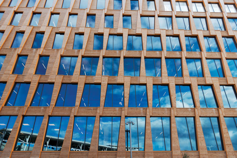 Exterior Valle Wood, Oslo. Mass timber office building. Photo by Anders Vestergaard Jensen | Unsplash